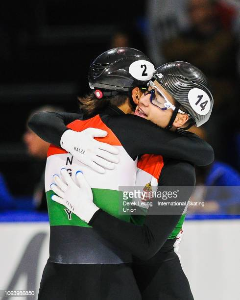 Shaolin Sandor Liu and Shaoang Liu of Hungary celebrate after placing first in the finals of the men's 5000m relay during the ISU World Cup Short...