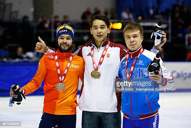 Shaolin Sandor Liu of Hungary celebrates his gold medal in the men's 500 meter final with Semen Elistraov of Russia who won silver and Sjinkie Knegt...