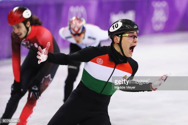 Shaolin Sandor Liu of Hungary celebrates winning the gold medal after the Men's 5000m Relay Final A on day thirteen of the PyeongChang 2018 Winter...