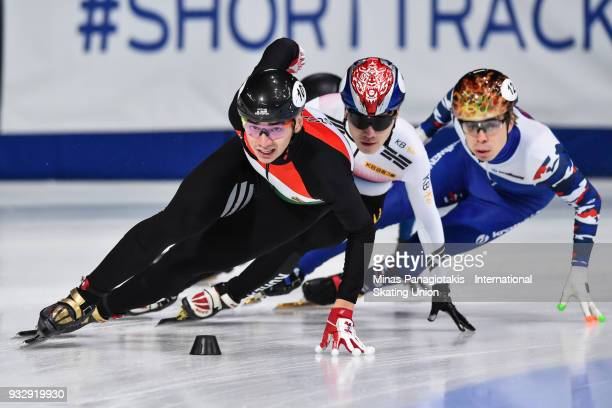 Shaolin Sandor Liu of Hungary competes against Yi Ra Seo of Korea and Semen Elistratov of Russia in the men's 1000 meter heat during the World Short...