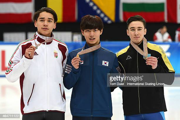 Shaolin Sandor Liu of Hungary Dagyeom Kim of Korea and Denis Nikisha of Kazakhstan pose during the medal ceremony for the Men's 500m final race on...