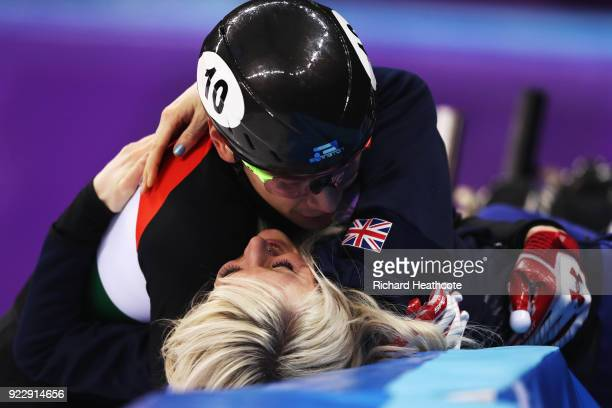 Shaolin Sandor Liu of Hungary embraces his girlfriend Elise Christie of Great Britain following the Short Track Skating Men's 5000m Relay Final A on...