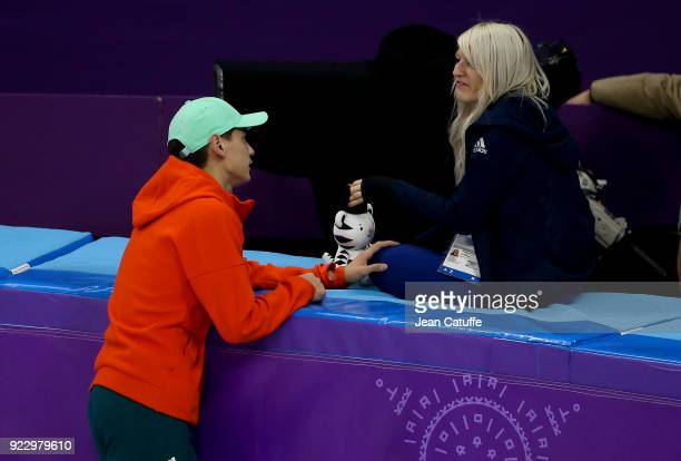 Shaolin Sandor Liu of Hungary offers to his girlfriend Elise Christie of Great Britain the mascot he just received during the venue victory ceremony...
