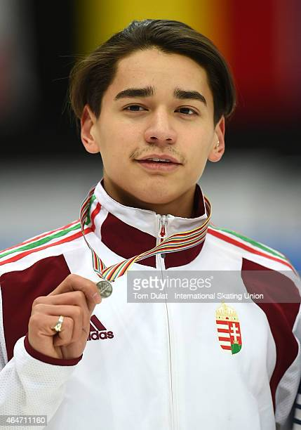 Shaolin Sandor Liu of Hungary poses during the medal ceremony for the Men's 500m final race on day two of the ISU World Junior Short Track Speed...