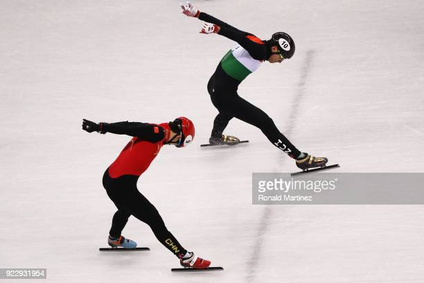 Shaolin Sandor Liu of Hungary reaches for the finish line ahead of Tianyu Han of China during the Men's 5000m Relay Final A on day thirteen of the...