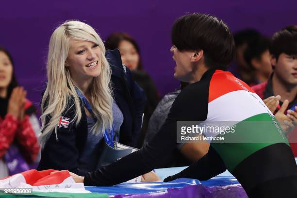 Shaolin Sandor Liu of Hungary talks with his girlfriend Elise Christie of Great Britain following the Short Track Skating Men's 5000m Relay Final A...