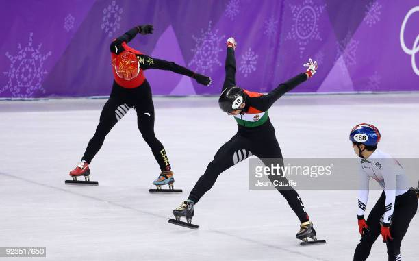Shaolin Sandor Liu of Hungary wins in front of Tianyu Han of China during the Short Track Speed Skating Men's 5000m Relay Final A on day thirteen of...