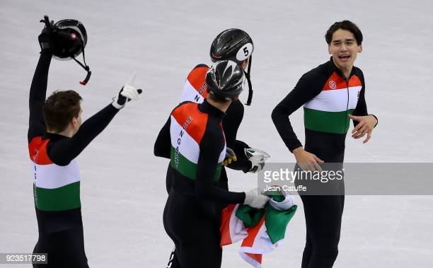 Shaolin Sandor Liu Shaoang Liu Viktor Knoch and Csaba Burjan of Hungary celebrate victory following the Short Track Speed Skating Men's 5000m Relay...