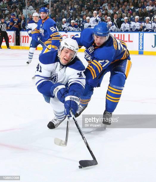 Shaone Morrisonn of the Buffalo Sabres knocks down Nikolai Kulemin of the Toronto Maple Leafs at HSBC Arena on February 5, 2011 in Buffalo, New York.