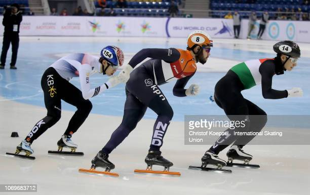 Shaong Liu of Hungary skates in front of Sjinkie Knegt of Netherlands and Lee June Seo of South Korea the during the men 1000 meter final A race...