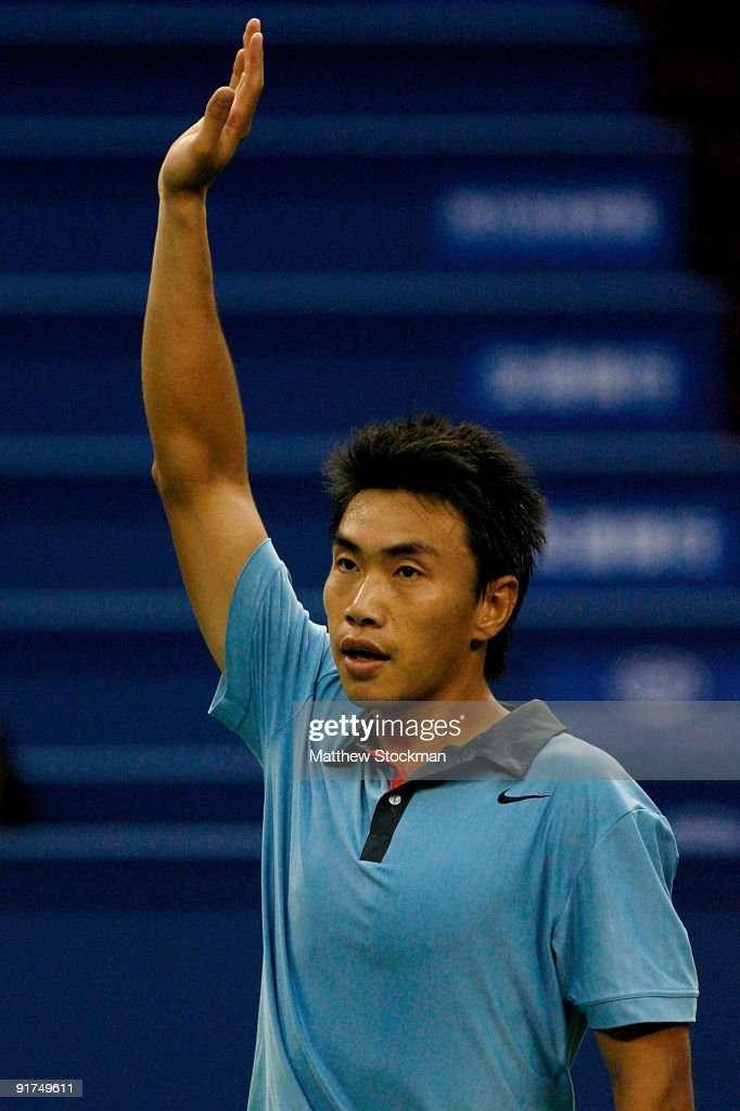 Shao-Xuan Zeng of China acknowledges the crowd after defeating Dudi Sela of Israel during day one of the 2009 Shanghai ATP Masters 1000 at Qi Zhong Tennis Centre on October 11, 2009 in