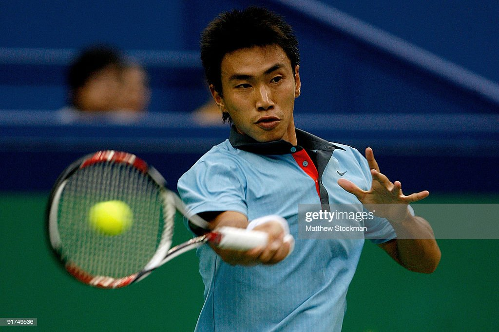 Shao-Xuan Zeng of China returns a shot to Dudi Sela of Israel during day one of the 2009 Shanghai ATP Masters 1000 at Qi Zhong Tennis Centre on October 11, 2009 in