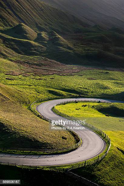 s shaped bend on a country road - bumpy stock photos and pictures