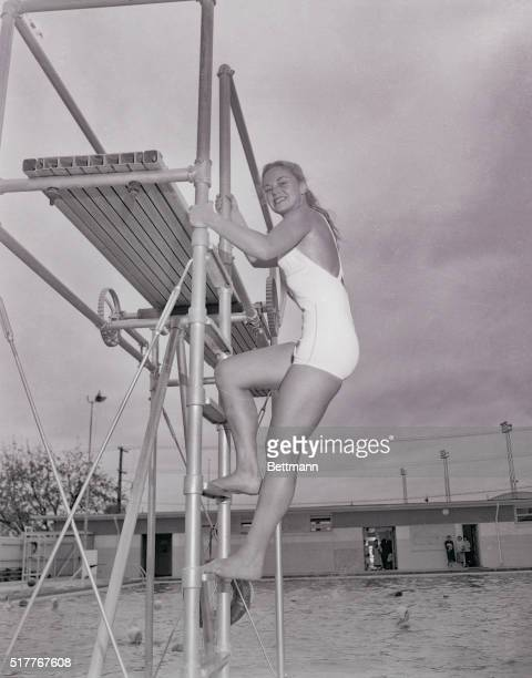 Shapely Bobbie Lorentz 18 year old Vallejo Calif coed climbs a ladder to the diving board from which she springs three hours a day five days a week...