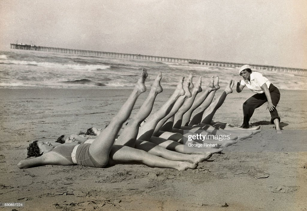 Women Exercising on Beach : News Photo