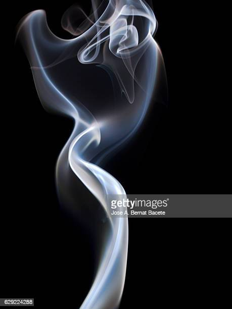 Shapes and figures of white smoke on a black background