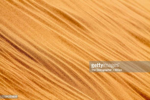 shapes of the sand - the storygrapher stockfoto's en -beelden
