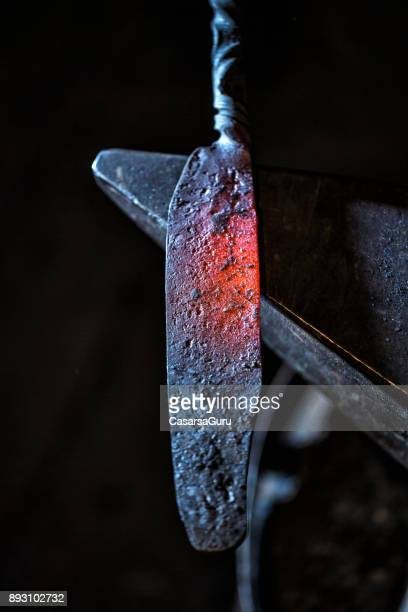 Shaping Glowing Iron Knife  Blade On Anvil