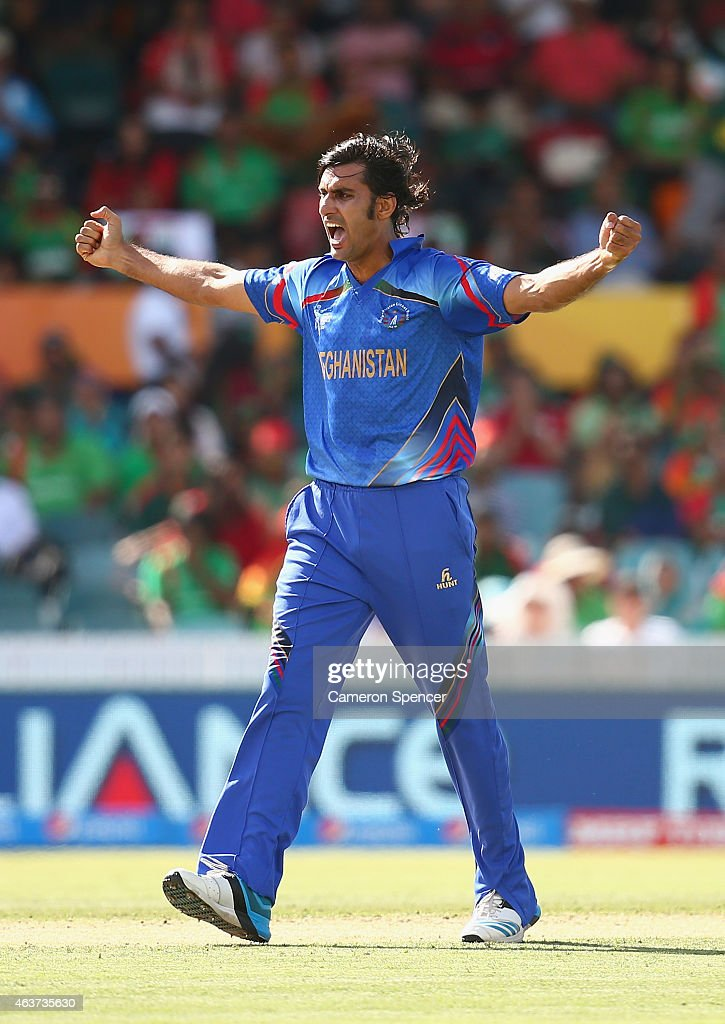Shapoor Zadran of Afghanistan celebrates dismissing Mohammad Mahmudullah of Bangladesh during the 2015 ICC Cricket World Cup match between Bangladesh and Afghanistan at Manuka Oval on February 18, 2015 in Canberra, Australia.