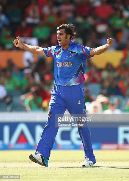 Shapoor Zadran of Afghanistan celebrates dismissing Mohammad Mahmudullah of Bangladesh during the 2015 ICC Cricket World Cup match between Bangladesh...