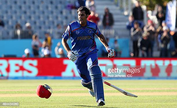 Shapoor Zadran of Afghanistan celebrates hitting the winning runs in Afghanistan's win over Scotland during the 2015 ICC Cricket World Cup match...