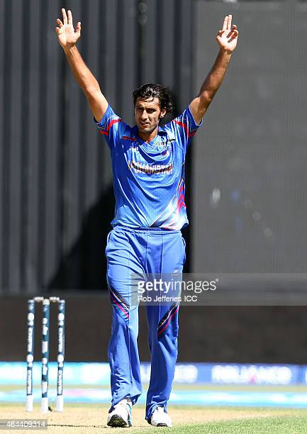 Shapoor Zadran of Afghanistan celebrates taking a wicket during the 2015 ICC Cricket World Cup match between Afghanistan and Scotland at University...
