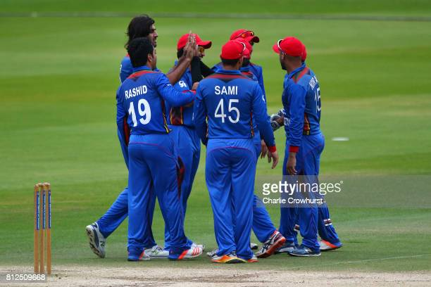 Shapoor Zadran of Afghanistan celebrates with team mates after claiming the wicket of Brendon McCullum of MCC hits out during the MCC v Afghanistan...