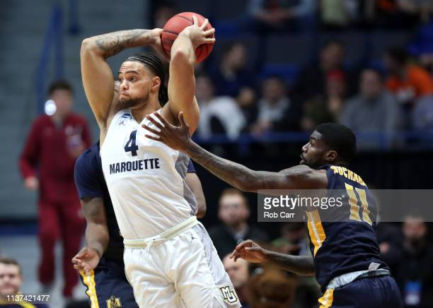 Shaq Buchanan of the Murray State Racers defends Theo John of the Marquette Golden Eagles during their first round game of the 2019 NCAA Men's...