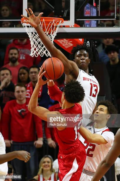 Shaq Carter of the Rutgers Scarlet Knights attempts to block a shot by Isaiah Roby of the Nebraska Cornhuskers during the second half of a game at...