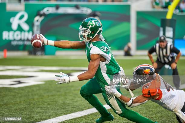 Shaq Evans of the Saskatchewan Roughriders escapes from Garry Peters of the BC Lions to score a touchdown in the game between the BC Lions and...