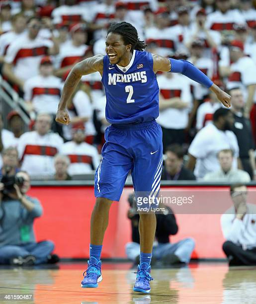 Shaq Goodwin of the Memphis Tigers celebrates after the 73-67 win over the Louisville Cardinals at KFC YUM! Center on January 9, 2014 in Louisville,...