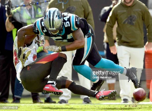 Shaq GreenThompson of the Carolina Panthers breaks up a pass intended for Peyton Barber of the Tampa Bay Buccaneers during their game at Bank of...