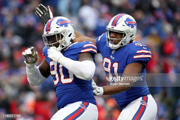 Shaq Lawson and teammate Ed Oliver both of the Buffalo Bills celebrate after a sack during the third quarter of an NFL game against the Denver...