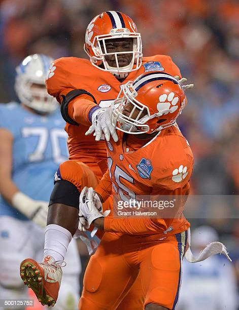 Shaq Lawson and TJ Green of the Clemson Tigers celebrate after sacking Marquise Williams of the North Carolina Tar Heels during the Atlantic Coast...
