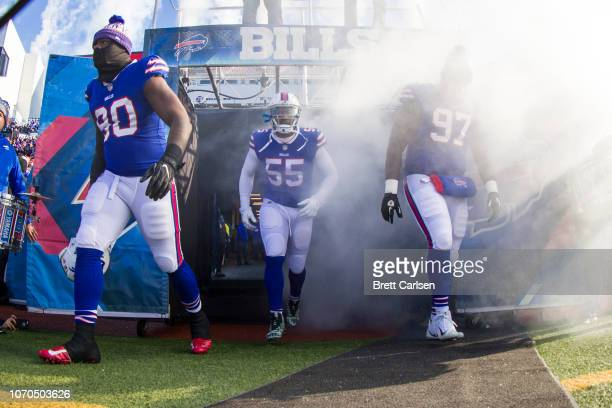 Shaq Lawson, Jerry Hughes and Jordan Phillips of the Buffalo Bills walk out of the tunnel before the game against the New York Jets at New Era Field...