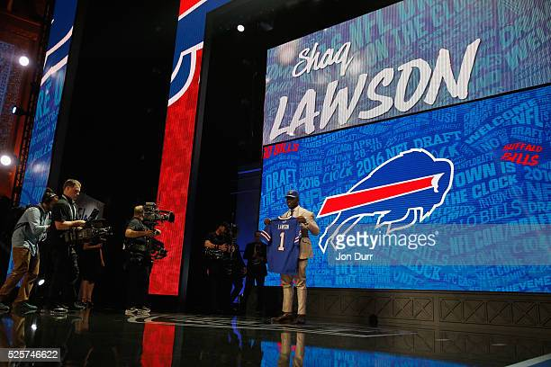 Shaq Lawson of Clemson holds up a jersey after being picked overall by the Buffalo Bills during the first round of the 2016 NFL Draft at the...