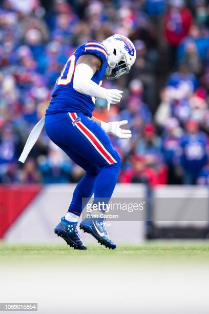 Shaq Lawson of the Buffalo Bills celebrates a sack against Ryan Tannehill of the Miami Dolphins during the second quarter at New Era Field on...