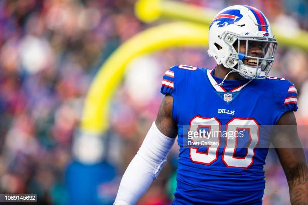 Shaq Lawson of the Buffalo Bills celebrates causing a turnover during the second quarter against the Miami Dolphins at New Era Field on December 30...