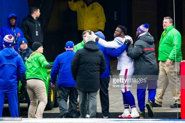 Shaq Lawson of the Buffalo Bills points and yells at Leonard Fournette of the Jacksonville Jaguars as the two are escorted off the field following...