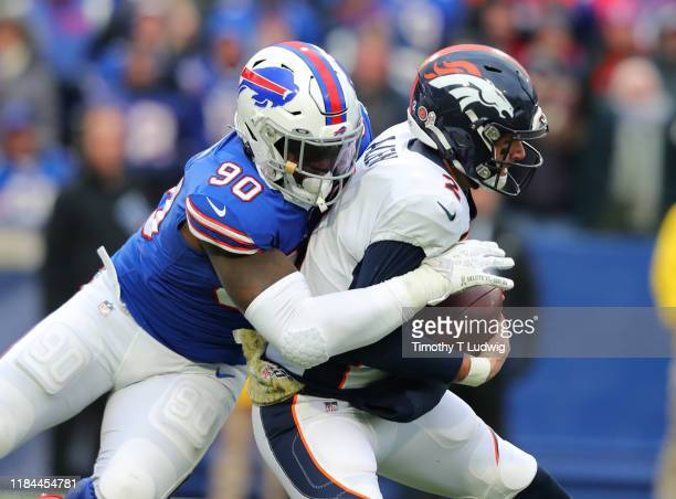 Shaq Lawson of the Buffalo Bills sacks Brandon Allen of the Denver Broncos during the second half at New Era Field on November 24 2019 in Orchard...