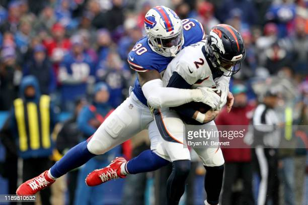 Shaq Lawson of the Buffalo Bills sacks Brandon Allen of the Denver Broncos during the third quarter of an NFL game at New Era Field on November 24...
