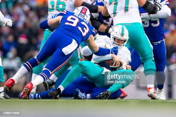 Shaq Lawson of the Buffalo Bills sacks Ryan Tannehill of the Miami Dolphins during the second quarter at New Era Field on December 30 2018 in Orchard...