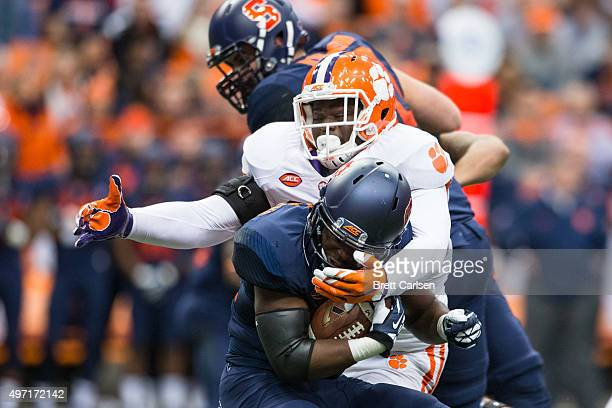 Shaq Lawson of the Clemson Tigers tackles Jordan Fredericks of the Syracuse Orange during the first half on November 14, 2015 at The Carrier Dome in...