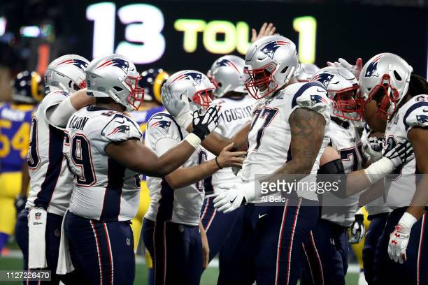 Shaq Mason and Trent Brown of the New England Patriots celebrate late in the game during their teams 133 win over the Los Angeles Rams during Super...