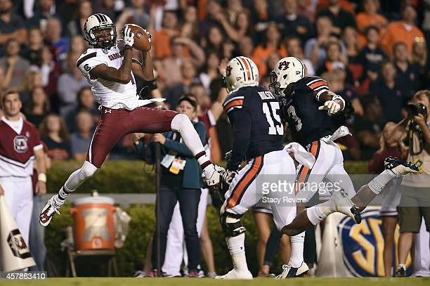 Shaq Roland of the South Carolina Gamecocks catches a pass for a touchdown in front of Joshua Holsey of the Auburn Tigers at Jordan Hare Stadium on...