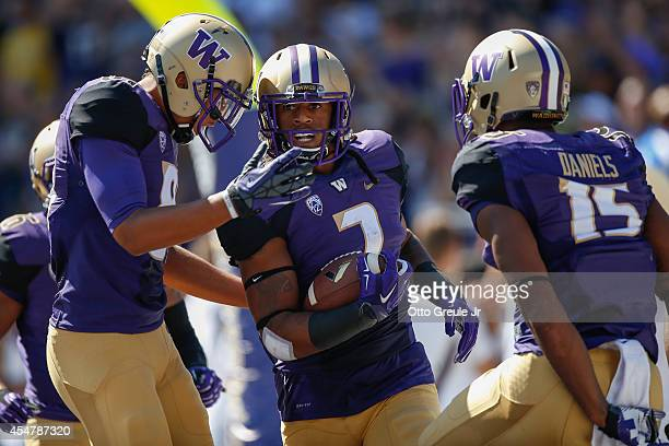Shaq Thompson of the Washington Huskies is congratulated by teammates after scoring a touchdown against the Eastern Washington Eagles on September 6,...