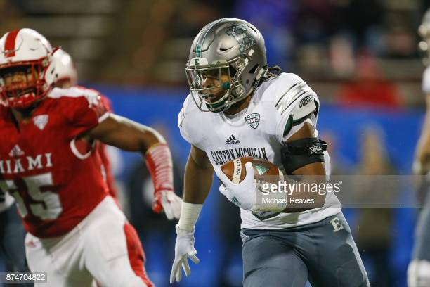 Shaq Vann of the Eastern Michigan Eagles runs with the ball against the Miami Ohio Redhawks during the first half at Yager Stadium on November 15...