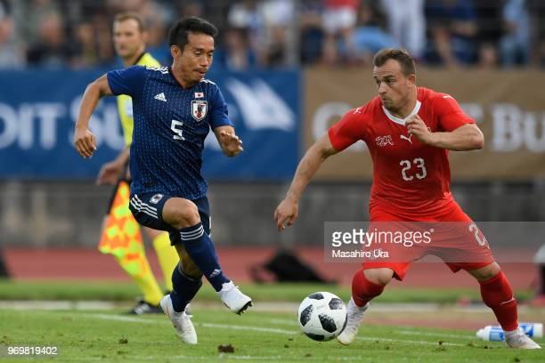 Shaqiri Xherdan of Switzerland and Yuto Nagatomo compete for the ball during the international friendly match between Switzerland and Japan at the...