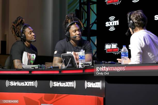 Shaquem Griffin and Shaquill Griffin of the Seattle Seahawks and SiriusXM host Chris Mad Dog Russo speak onstage during day 1 with SiriusXM at Super...