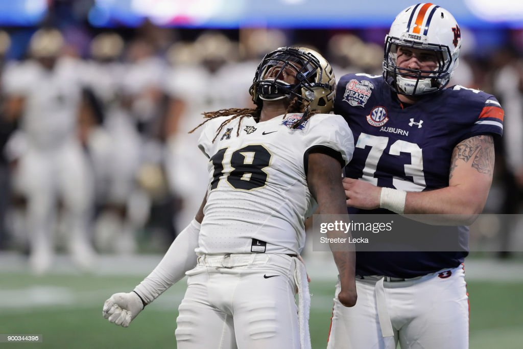 Shaquem Griffin #18 of the UCF Knights celebrates after sacking Jarrett Stidham #8 of the Auburn Tigers (not pictured) in the third quarter during the Chick-fil-A Peach Bowl at Mercedes-Benz Stadium on January 1, 2018 in Atlanta, Georgia.